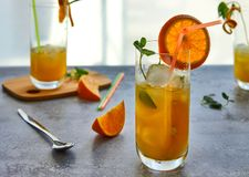 Photo of fresh orange juice in the glass jar. Summer healthy organic drink concept stock images