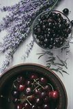 Composition with fruits of cherry and currant and flowers lavender on a white background royalty free stock image