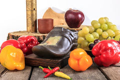 Photo of fruits and vegetables on old vintage table Stock Photos