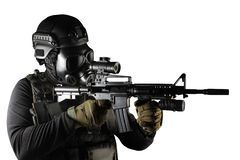 Isolated warrior soldier in gas mask and rifle aiming