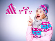 Photo of a fun surprised woman with illustration of gifts royalty free stock images