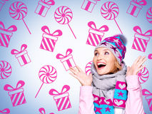 Photo of a fun surprised woman with illustration of gifts stock photos