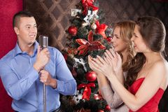 Photo of funny guy singing at party. Stock Images