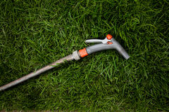 Photo of garden hosepipe lying on fresh green grass Stock Photo