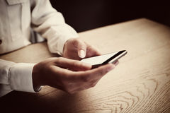 Photo of generic design smart phone holding in female hands for texting message. Horizontal Stock Photography