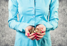Girl with a coins Stock Photos