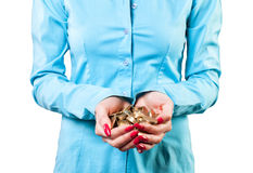 Girl with a coins Royalty Free Stock Image