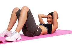A photo of a girl doing stomach crunches Stock Photos