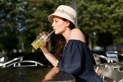Photo of girl in hat with glass Stock Photo