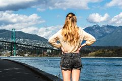 Girl at Lions Gate Bridge in Vancouver, BC, Canada Royalty Free Stock Images