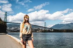 Girl at Lions Gate Bridge in Vancouver, BC, Canada Stock Photo