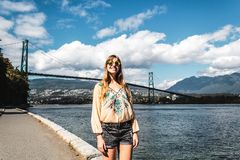 Girl at Lions Gate Bridge in Vancouver, BC, Canada Royalty Free Stock Image