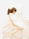 photo of girl lying in bed and covering with blanket Stock Image