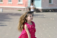 Photo girl running down the street on a sunny day. Photo cheerful girl running down the street on a summer day Stock Images