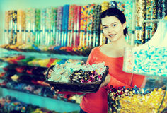 Photo of  girl in the shop   with lots of sweets Stock Photo