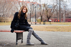 Girl on bench. Girl in park sitting on the bench Royalty Free Stock Photo
