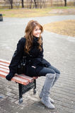 Teen girl sitting on the bench. Girl in park sitting on the bench Royalty Free Stock Images