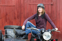 Photo of girl on a vintage motorbike in pilot cap. Photo of girl on vintage motorbike in pilot cap Royalty Free Stock Photos