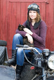 Photo of girl on a vintage motorbike in pilot cap with cat Royalty Free Stock Photos