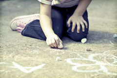 Photo of girl writing with chalk on the schoolyard Royalty Free Stock Photos