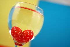Photo glass. Photo red dices in the glass of water ,drink your luck concept Stock Photos