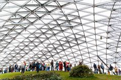 Photo of glass roof and tourists stock images