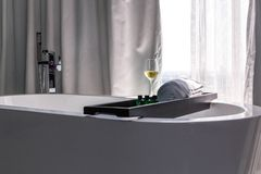 A glass of wine in the bathroom overlooking the city stock photos