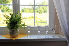 Photo with glasses of champagne. On windowsill Royalty Free Stock Image