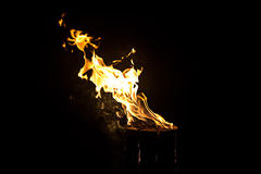 Photo of glowing log, fire by night Royalty Free Stock Image