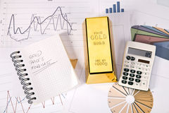 Photo of gold bars. On graphs and statistics, studio shots, closeup Stock Photography