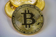 Photo Of Golden Bitcoin virtual currency coin. Stock Photos