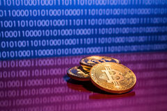 Photo golden bitcoins on blue digital background. Trading concept of crypto currency Stock Photo