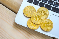 Photo Golden Bitcoins On laptop. Trading Concept Of Crypto Currency Royalty Free Stock Photography