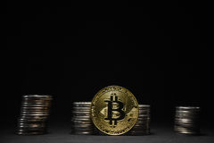 Golden bitcoin with money coins background. Bitcoin on black background Stock Photo