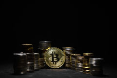Golden bitcoin with money on balck background. Bit coin cryptocurrency banking money transfer business technology Royalty Free Stock Image