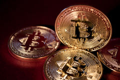 Photo Golden Bitcoins On Red Background. Trading Concept Of Crypto Currency royalty free stock photos