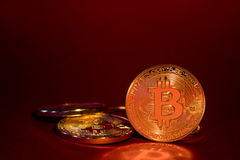 Photo Golden Bitcoins On Red Background. Trading Concept Of Crypto Currency Stock Images