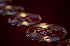 Photo Golden Bitcoins On Red Background. Trading Concept Of Crypto Currency. Golden Bitcoins On Red Background. Trading Concept Of Crypto Currency Royalty Free Stock Image