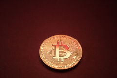 Photo Golden Bitcoins On Red Background. Trading Concept Of Crypto Currency Royalty Free Stock Photography
