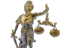 Golden statue of Justice on white royalty free stock photos