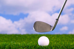 Photo of a golf club hitting ball Royalty Free Stock Image