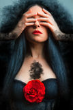 Photo of a gothic woman. Vogue style photo of a gothic woman with red rose Stock Images