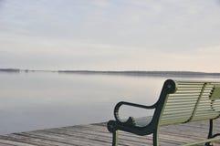 Photo of Gray Metal Bench Near Sea Royalty Free Stock Photo