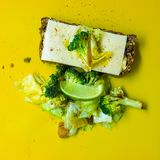 Photo of Green Broccoli, White Cheese and Green Cabbage on Yellow Surface Royalty Free Stock Photos