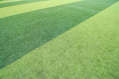 Photo of a green synthetic grass sports field Stock Photos