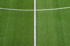 Photo of a green synthetic grass sports field with white line sh stock photo