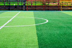 Photo of a green synthetic grass sports field with white line sh. Ot from above Stock Photo