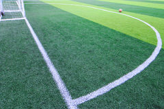 Photo of a green synthetic grass sports field with white line sh. Ot from above Royalty Free Stock Image