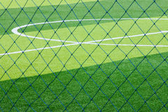 Photo of a green synthetic grass sports field with white line sh. Ot from above stock photos