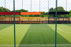 Photo of a green synthetic grass sports field with white line sh Stock Image